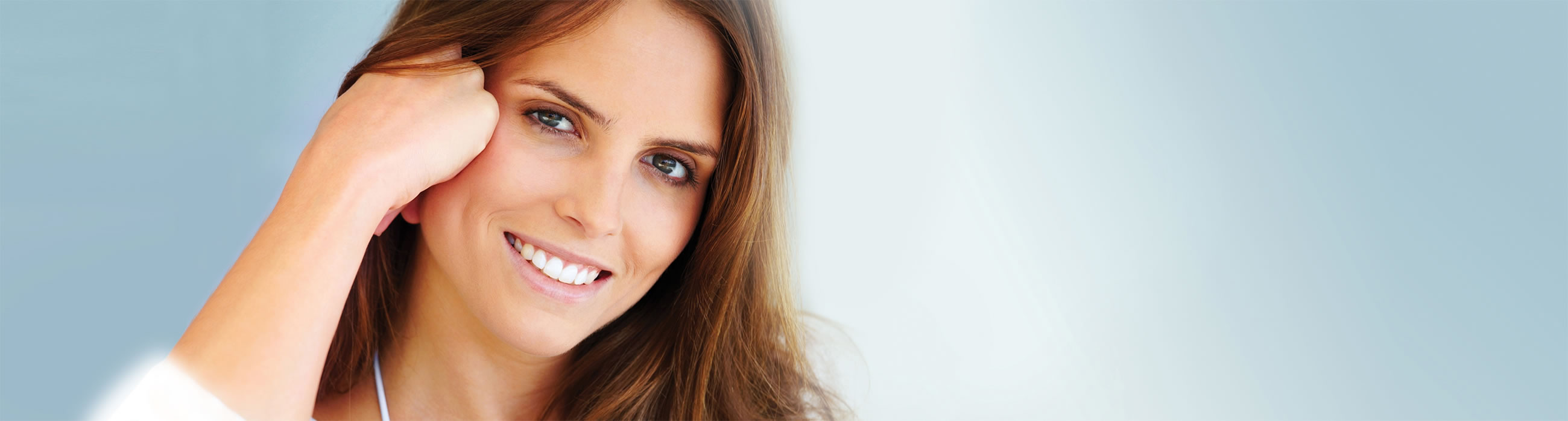 Female smiling and posing at our Watford dentist, Senova Dental Studios in Watford, Hertfordshire