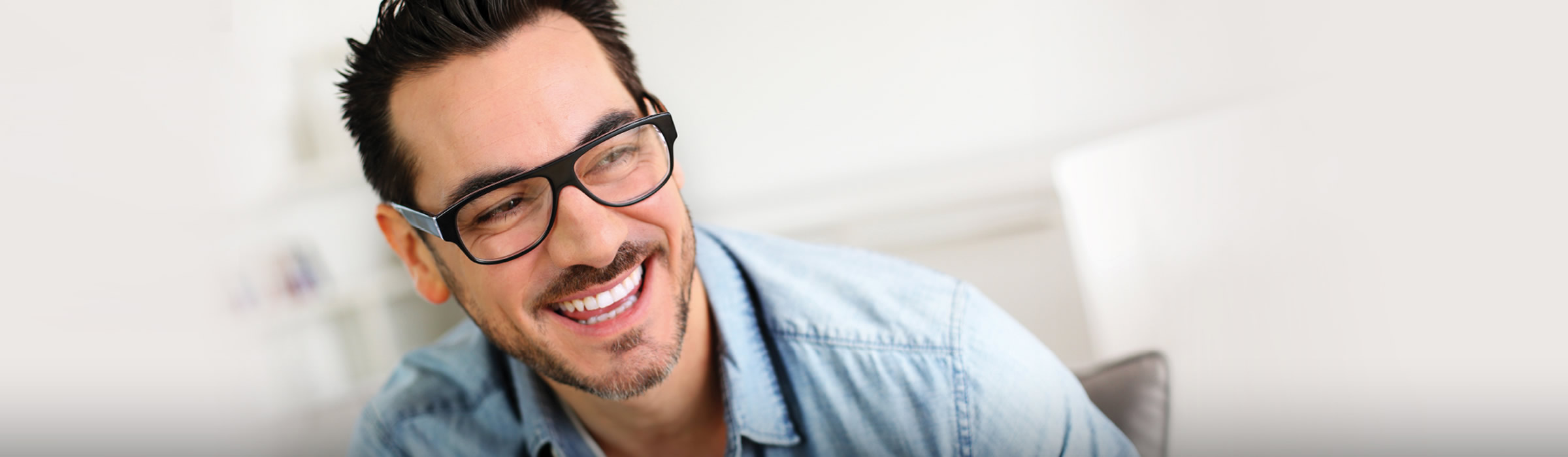 Man in glasses smiling. Teeth whitening dentist in Watford, Hertfordshire.