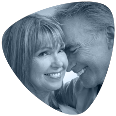 Mature couple smiling. Senova Dental Studios is a dentist offering dental implants Watford, Hertfordshire.