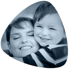 Boy with his mother smiling. Senova Dental Studios is a general dentist in Watford, Hertfordshire.